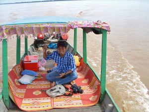 dolphin boat tour mekong river kratie one guide smiling