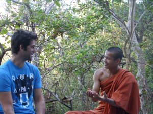 Phnom Sambok Hill Kratie Buddhist monk talking smiling trees nature